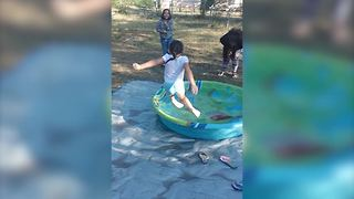 Young Girl Slips As She Attempts To Jump Into A Kiddie Pool - Video