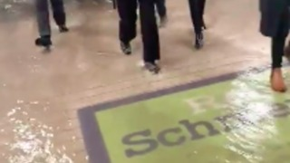 Commuters Walk Through Flooded Didcot Parkway Station - Video
