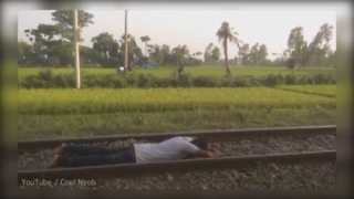 Man Performs Daring Train Stunt - Video
