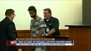 Man accused of stealing car with children inside