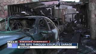 Couple escapes injury after fire rips through garage - Video