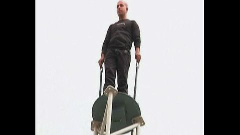 Man Stands On Pole For 35 Hours