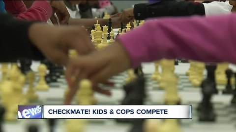 Community police using chess to mentor students