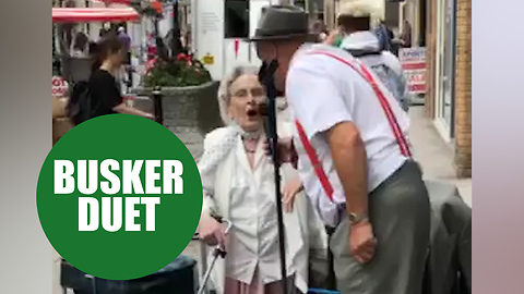 Pensioner performs duet of 'Wonderful World' with busker