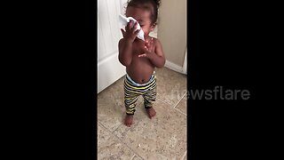 Cute baby imitates someone blowing their nose