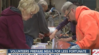 Volunteers prepare meals for Thanksgiving