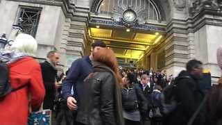 Commuters Stream Out of Waterloo Station's Main Entrance - Video