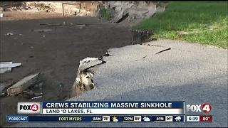 Crews look at stability of Florida sinkhole that ate 2 homes - Video
