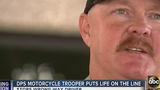 DPS trooper makes heroic move, stops wrong-way driver