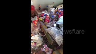 Woman finds her let piled with rubbish - Video