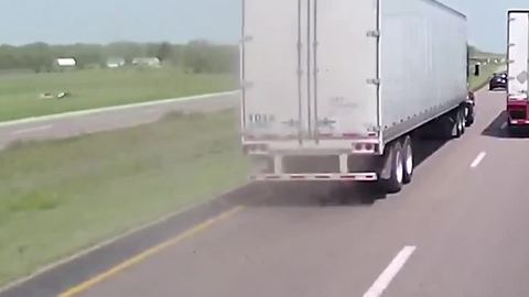 Damaged Tire Of Passing Truck Blows With Loud Sound