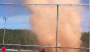 Dust Devil Whirls Through Ontario Softball Match - Video