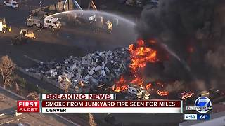 Raging fire breaks out at Denver recycling plant - Video