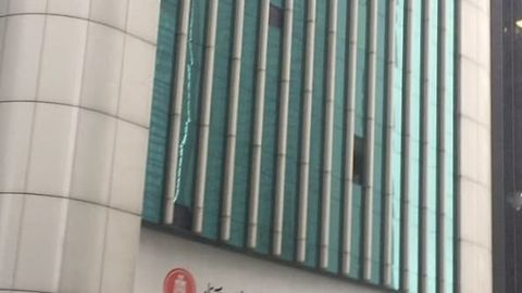 Typhoon Hato Knocks Out Window Panes at Hong Kong's Hang Seng Bank