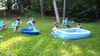 Woman Trips and Falls Into Wading Pool - Video