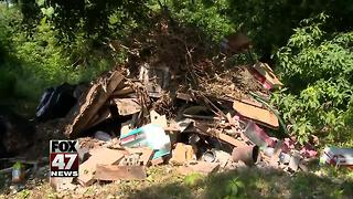Neighbors tired of looking at trash illegally dumped on property - Video