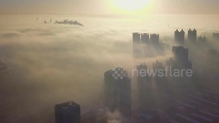 City above the clouds: Time-lapse shows dense fog in China's Shenyang - Video