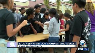 Palm Beach Harvest teams with students to distribute free meals