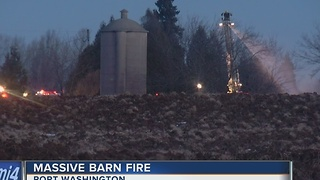 Multiple fire departments battle massive Port Washington barn fire - Video