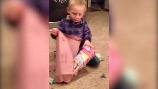 """A Tot Boy Opens A Christmas Present And Finds A Barbie Doll"""