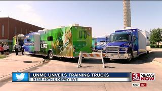 UNMC unveils training trucks - Video