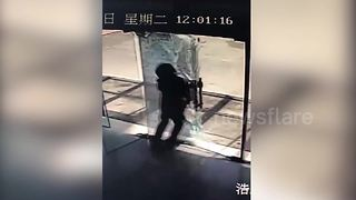 Distracted Delivery Man Shatters Glass Door By Walking Into It - Video
