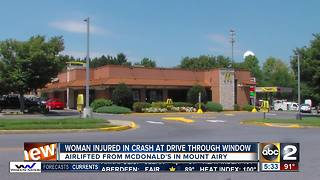 Woman injured in crash at McDonalds drive thru window - Video