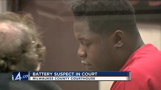 Battery suspect in court after hitting officers - Video
