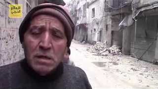 Regime Video Shows Civilians Flee Besieged Aleppo Neighborhood - Video