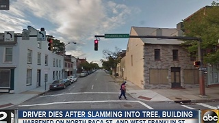 Driver dies after slamming into tree, building in downtown Baltimore