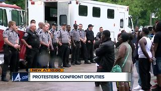Protesters confront deputies after 19-year-old killed near the lakefront - Video