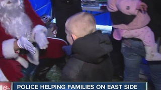 Indianapolis police help families on the city's east side during