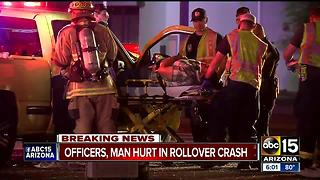 Phoenix police investigating after two officers hurt in rollover wreck - Video