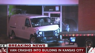 Van crashes into two downtown businesses, driver injured - Video