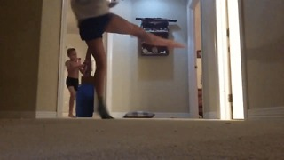 Girl Takes Out Brother With Spinning Kick to the Head While Dancing - Video