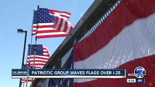 Patriotic group waves flags over I-25 - Video