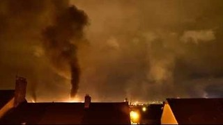 Fire and Smoke Rise Above Belfast in Eleventh Night Timelapse - Video