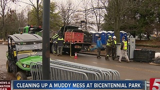Workers Clean Up Muddy Bicentennial Park - Video