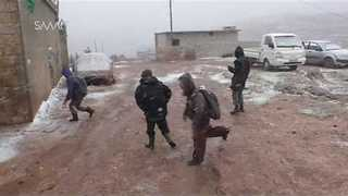 Children Make the Most of Syria Snowfall - Video