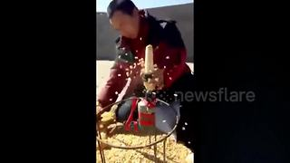 Resourceful Farmer Uses Power Drill To Shuck Corn - Video