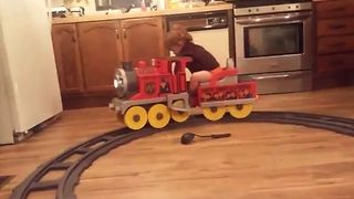 Boy Falls Asleep On Toy Train