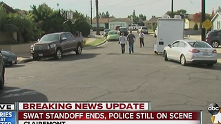 Swat standoff ends, police still on scene - Video