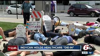 IndyCan holds health care 'die-in' - Video