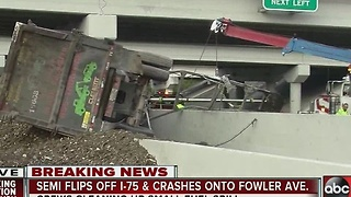 Semi flips off I-75 and crashes onto Fowler Avenue - Video