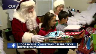Police deliver Christmas presents to families in Mt Pleasant - Video