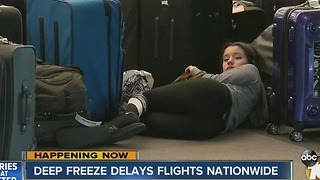 Deep freeze delays flights nationwide - Video