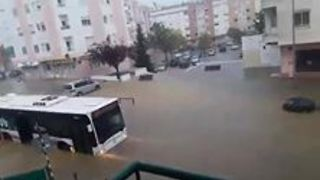 Severe Flooding in Lisbon Submerges Cars on Roads - Video
