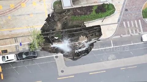 Huge sinkhole swallows minivan in southern China