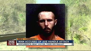 Police arrest man for robbing, beating victim with axe handle - Video