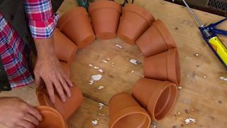 creates some funky terracotta garden art - Video